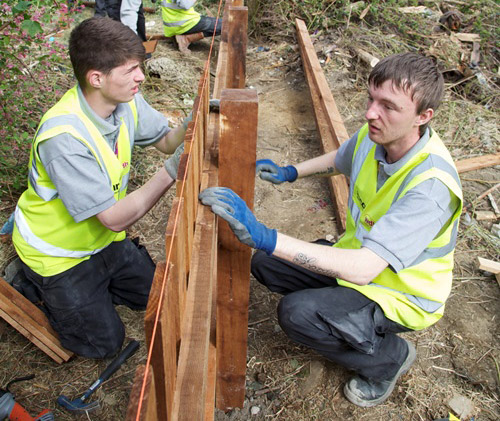 Trainee fence builders at work
