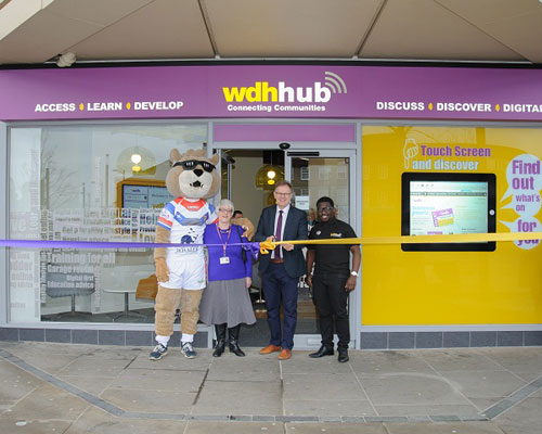 Kevin Dodd with WDH staff, cutting the ribbon to open the WDH Hub